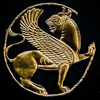 Persian Roundel  Achaemenid Period  Reign of Artaxerxes II, ca. 404-359 B.C.  This snarling winged lion worked in gold repoussé attests to the exceptional skill of Achaemenid goldsmiths. The back of the horned feline's body and the slender twisted cord that surrounds it bear sixteen tiny loops for attachment to a garment or textile.