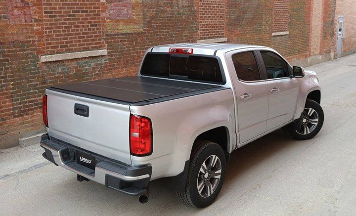 We are excited to bring you an exclusive product available nowhere else in Canada the LOMAX Hard Tri-Fold Tonneau Cover! With panels constructed from the same aluminum alloy that is used in trailer construction and extruded aluminum support channels this tonneau cover is not only extremely light but also durable! It can hold up to 400 pounds of distributed weight and the aluminum which is coated in a textured black finish is nearly impervious to rust and corrosion. The LOMAX Hard Tri-Fold…