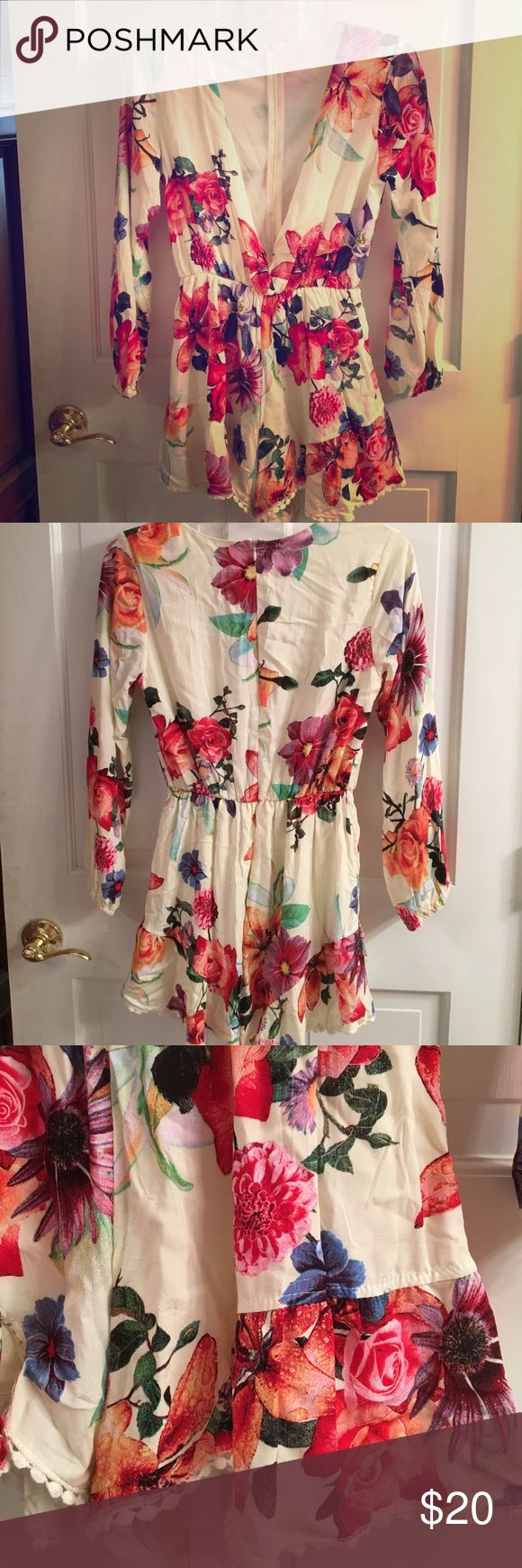 Plunging V-Neck floral romper Love this deep plunging v-neck floral romper. Perfect for a hot summer night out! Dresses Long Sleeve