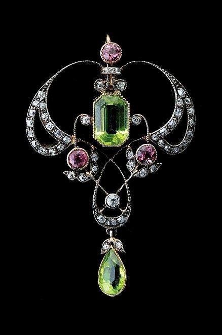 Art Nouveau peridot, tourmaline, diamond, sterling silver, and gold pendant.