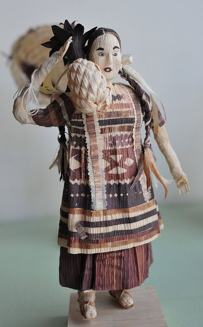 MEXICAN CORN HUSK DOLL: This wonderful figure of a woman is made using totomoxtle, or dried corn husks. She represents a Chinantec woman from the Papaloapan region of northern Oaxaca. she carries a pineapple during a famous traditional dance -- La Danza de la Flor de Pina. From an exhibit of Oaxacan crafts by master artists at the state folk art museum in San Bartolo Coyotepec, Oaxaca.