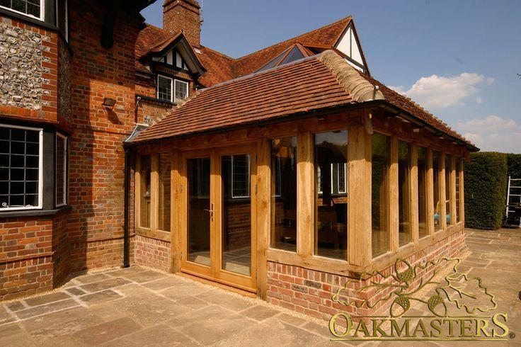 Oak-frame glazed patio doors of orangery on listed brick manor house