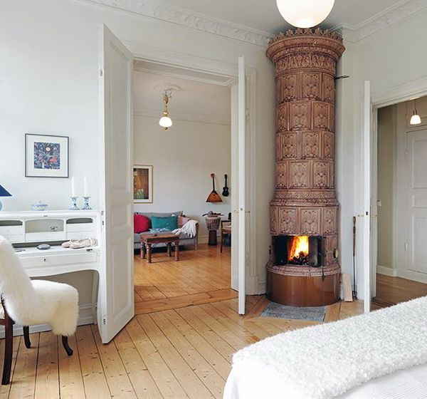 Typical Swedish fireplaces usually resemble a column. The shape is very simple. It's basically a round chimney pipe and it's usually white. Other traditional Swedish fireplace designs include brick structures usually with veneer tiles. The furnace always presents two small folding doors and the top of the fireplace almost always features a crown, in the spirit of the Scandinavian monarchies traditions.