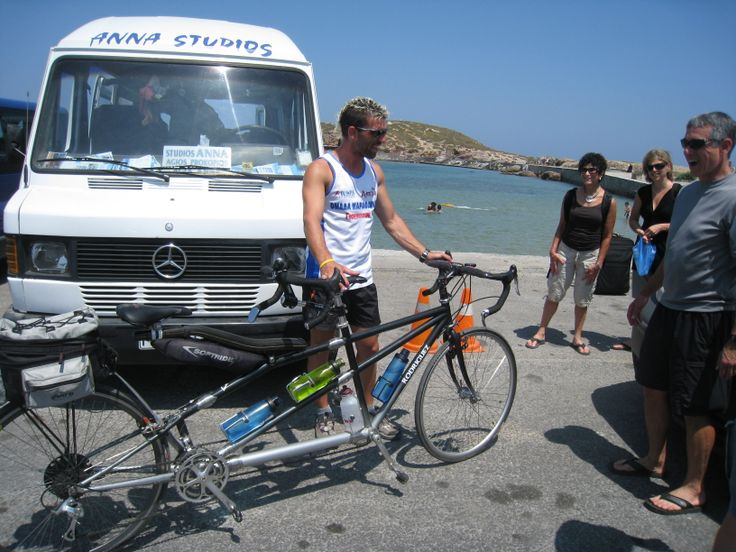 Driver Foti examines Mark and Susan's tandem in the port parking lot.