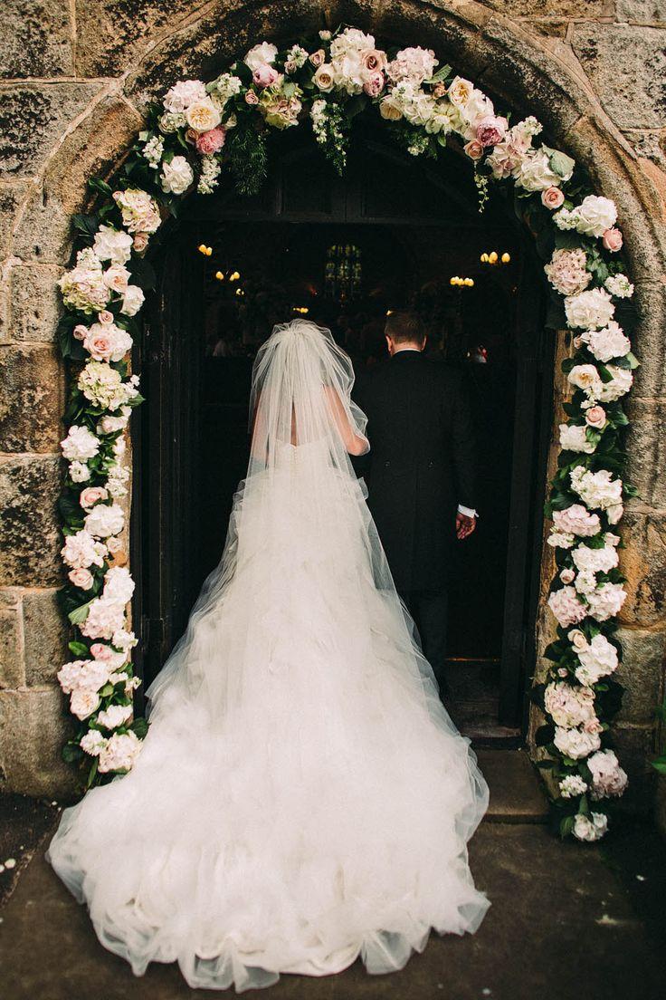 Ian Stuart Pracatan Ruffle Wedding Dress | Flower Arch | Lawson Photography | http://www.rockmywedding.co.uk/rebecca-jamie/