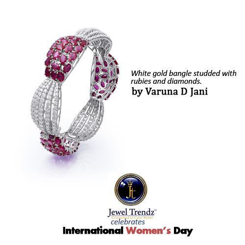 White #gold bangle studded with #rubies and #diamonds.  #Jewellery by Varuna D Jani.