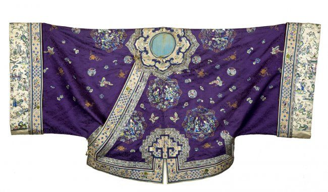Chinese Embroidered Coat, finely hand worked wrap around coat with an ivory double border and domestic scenes of people set on a purple ground with metallic and silk thread, lined with a light blue silk, round gold colored metallic button with a pierced and engraved design, slight discoloration to the blue liner, late 19th c