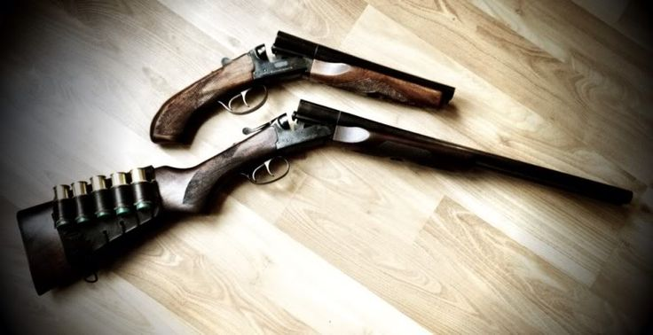 Double barrel shotgun and a sawed off double barrel.