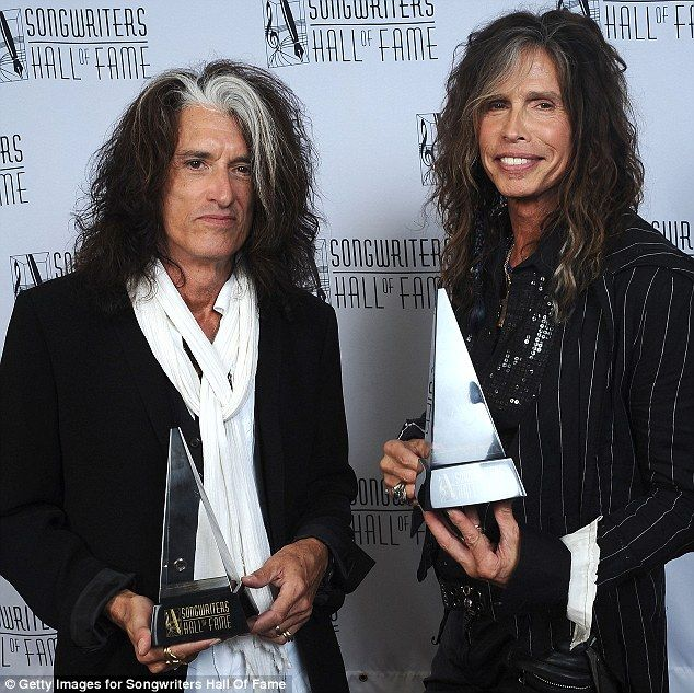Glass act: Joe Perry simply could not stop smiling as he revelled in the moment with Aerosmith cohort Steven Tyler