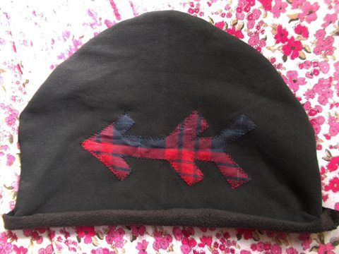 Winter hat with arrow.