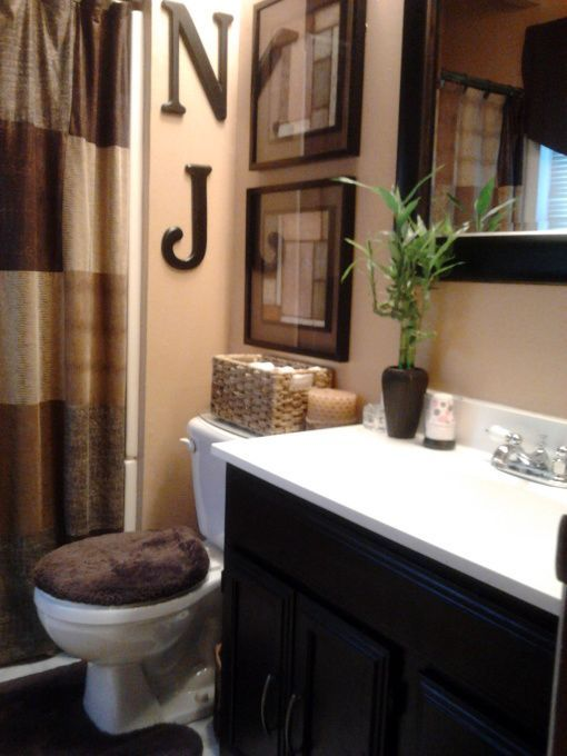25 best ideas about brown bathroom on pinterest brown bathroom decor brown bathroom mirrors - Bathroom decorating ideas blue walls ...