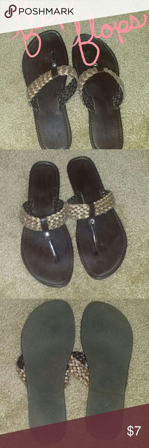 JCPenny flip flops Great condition.  Dark brown with braided glitter straps.  ❌trades   ❤ships within 3 business days   😁free gift while supplies last jcpenney Shoes Sandals