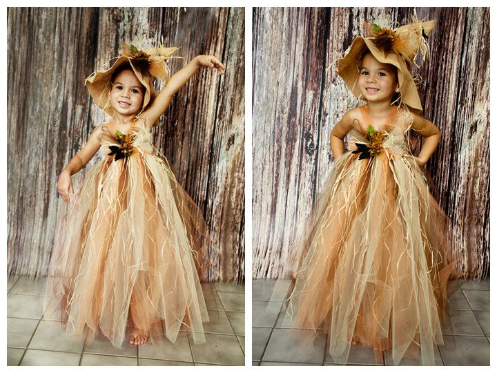 Scarecrow tutu dress. Crocheted top and with raffia and matching hat . Flower and crow embellishments.