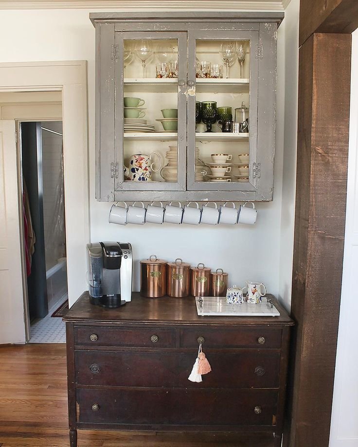 Kinda loving this set up with dresser on bottom for closed storage and old cabinet above for open storage, with a coffee bar sandwiched in between.