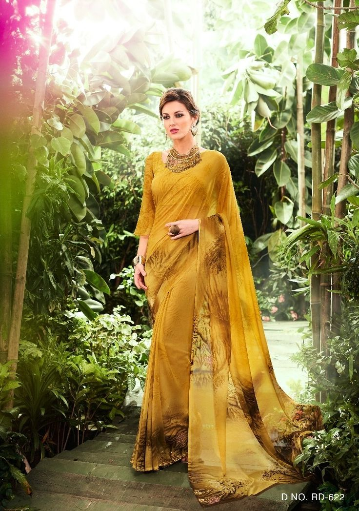 Price @1089.00 INR  Colour : Mustard  Saree Fabric : Georgette  Blouse Fabric : Fancy Blouse  Work : Printed With Attached Border
