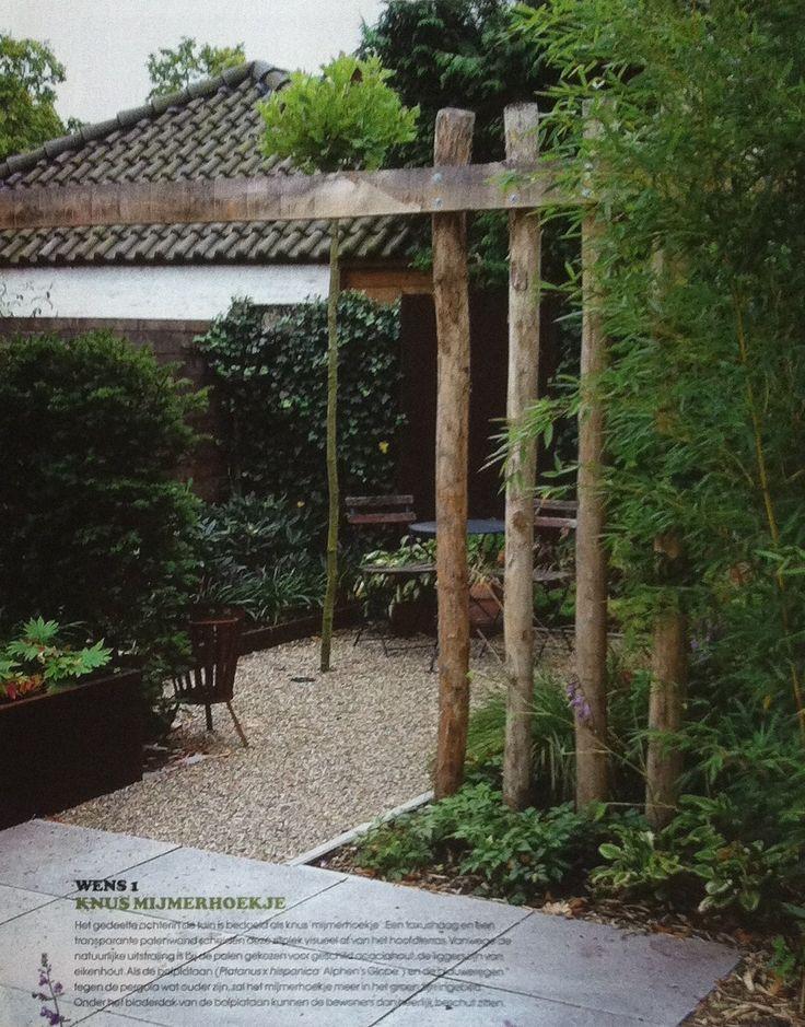 Transparante palenwand van geschild acaciahout (palen) en eikenhout (liggers)