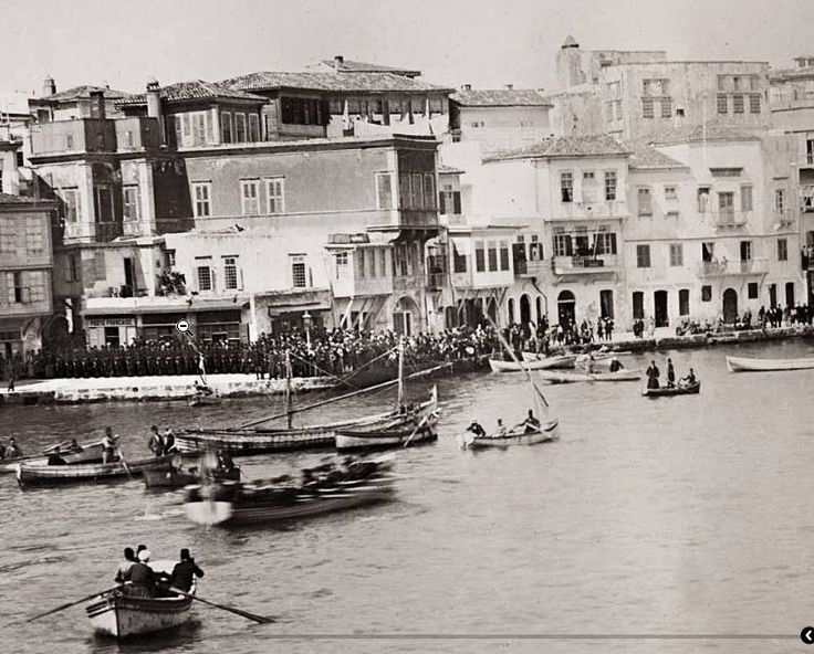 Chania...1898 Religious ceremony (probably epiphany) at Topanas quayside (present day Akti Koundourioti)...in the background is Fort Firka....