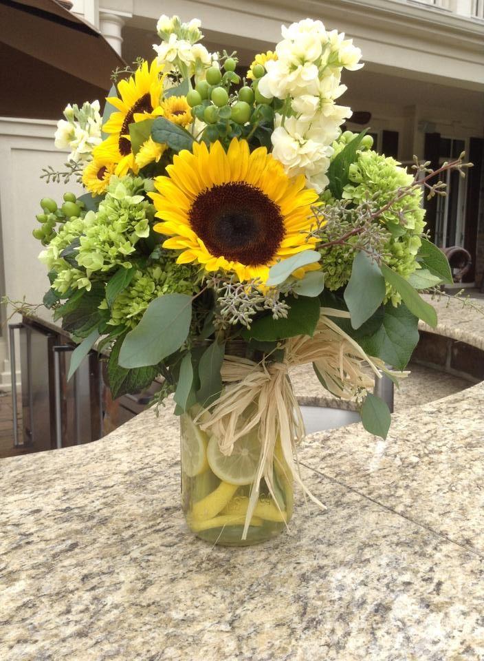 Rafia lemon slices give our sunflower mason jar