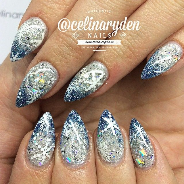 "Frozen Elsa nails! ✨❄️ Using Light Elegance ""Snow Queen"" and ""Ice breaker"" with some handpainted snowflakes ❄️ ***Please note that I'm not answering any questions about prices here on my insta, please check out my website for all the information you need: WWW.CELINASNAGLAR.SE (only in swedish). Facebook: www.facebook.com/celinasnaglar.  Rude comments and spam will be deleted and blocked. #celinasnaglar #lightelegance #nailsmagazine #nailpromagazine #nailartgallery #ghmanicure #nailprodigy…"