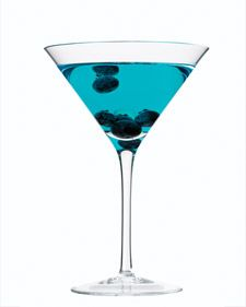 Blueprint Martini (1/4 cup vodka  1 tablespoon cointreau  1/2 teaspoon blue curacao  3 to 6 fresh blueberries)
