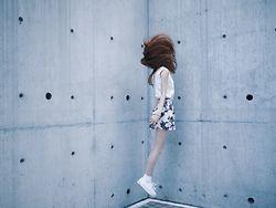 Una Yeung - Vivaladiva White Vest, Vivaladiva Floral Print Skirt, Superga White Sneakers, White Socks, Links London Bracelet - MOOD SHOT