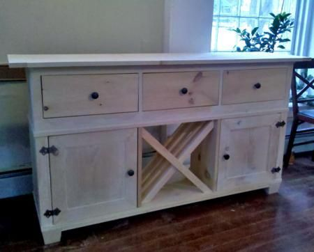 I want to make this! DIY Furniture Plan from Ana-White.com A buffet featuring wine storage, two large cubbies with doors and three large drawers.