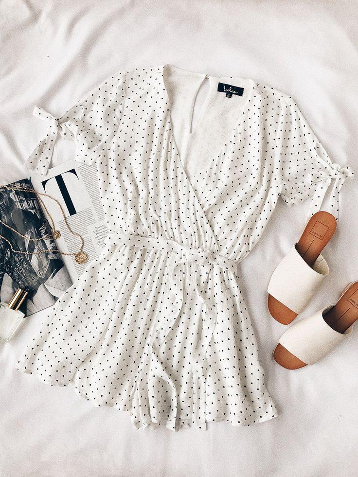 Feminine, ruffle sleeve, mini polka dot romper. Perfect for coastal summer life.