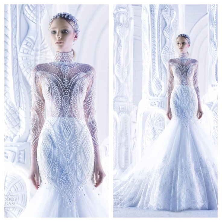 Michael Cinco ~ high neck long sleeve mermaid gown with intricate bodice. ❤