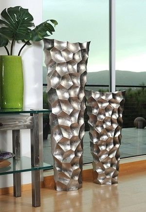 Stone Age Floor Vases Set. This original design features a dove grey lacquer finish that provides the look of stone. Large vase measures almost 5 feet tall. Hebi Arts. $1702