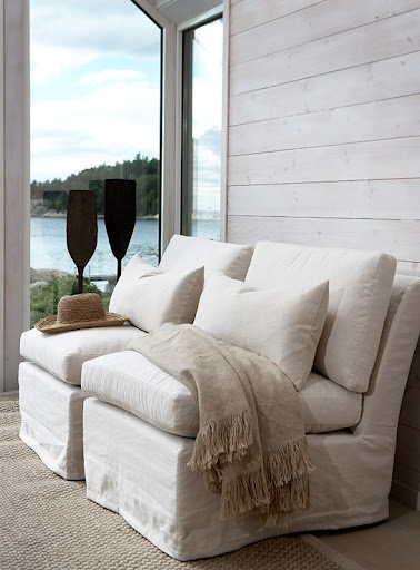 Lovely simple neutral space with sophisticated beige throw blanket