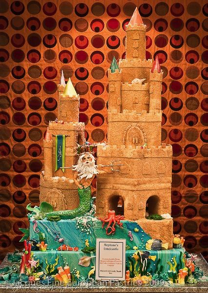 Neptune's underwater sand castle wedding cake