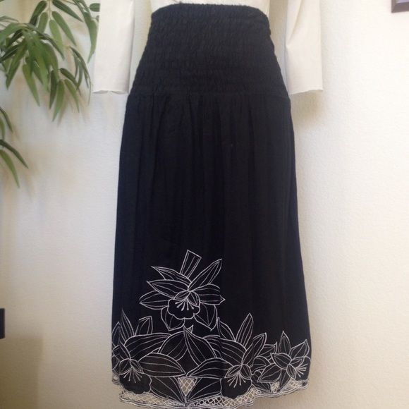 """Smocked top dress/skirt Black smock top that can be worn as a dress or skirt. Striking white embroidered floral design on hem and lower front. Hand washable rayon. The stretchy smocked top measures 13 inches before stretching, stretches to 19"""". Length is 31"""". Tagged small but easily fits medium as well. Excellent used condition, no stains or tears.' Blue Bamboo Dresses Strapless"""