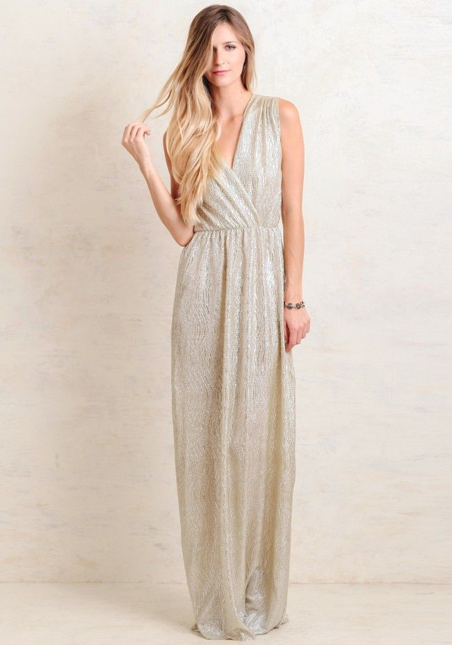 Finished with a silver metallic sheen, this enchanting gold-toned maxi dress features a flattering surplice neckline and back with gathering at the waist for a defined silhouette.