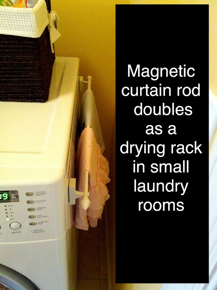 Magnetic curtain rod doubles as a drying rack in a small laundry room. …