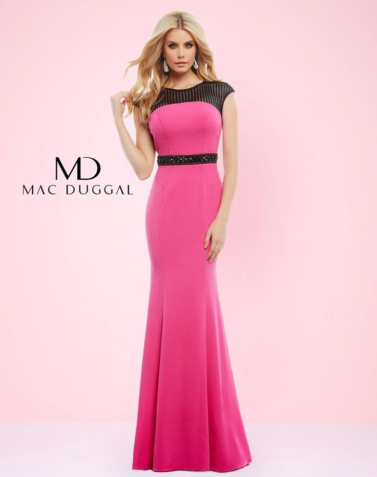 Two-tone trumpet skirt prom dress with mesh capped sleeve, beaded belt and open back. Available in Fuchsia/Black and White/Black.