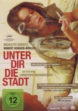 Unter dir die Stadt  2010 Germany,France      Jetzt bei Amazon Kaufen Jetzt als Blu-ray oder DVD bei Amazon.de bestellen  IMDB Rating 6,4 (312)  Darsteller: Nicolette Krebitz, Robert Hunger-Bühler, Mark Waschke, Corinna Kirchhoff, Lamou Vissay,  Genre: ,  FSK: 12
