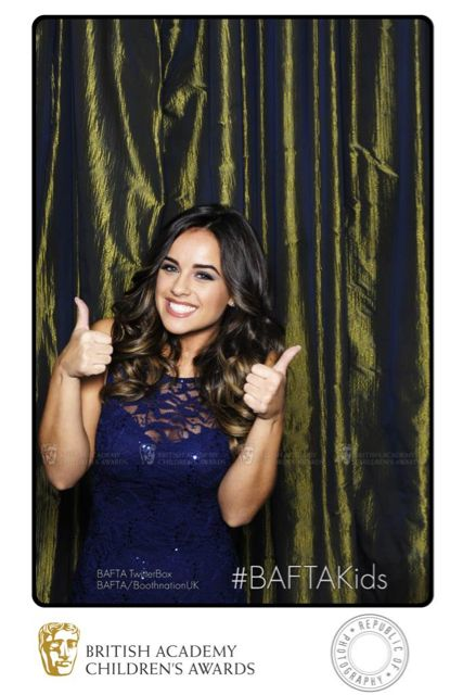 Actress Georgia May Foote shows her approval of the BAFTA Children's Awards winners with a double thumbs up