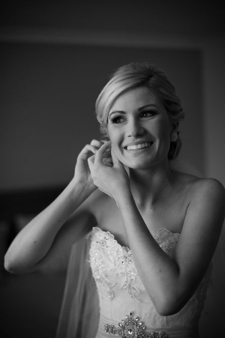 We love capturing brides getting ready as their excitement builds. Putting on the earrings is one of these moments. #weddingphotography #markjayphotography #sydneyweddingphotographer #bride #weddingday #pose #blackandwhite #bridestyle