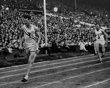 Mel Patton, left, anchor man of the U.S. men's 4 x 100-meter relay team, crosses the finish line well ahead of Britain's Jack Archer, during the Summer Olympics at Wembley Stadium, in London Aug. 7, 1948. Olympic judges disqualified the U.S. team on the grounds that their first exchange of the baton was not made within the 20-meter zone, but reversed their decision three days later giving the U.S. the gold medal and Britain the silver.(AP Photo)...