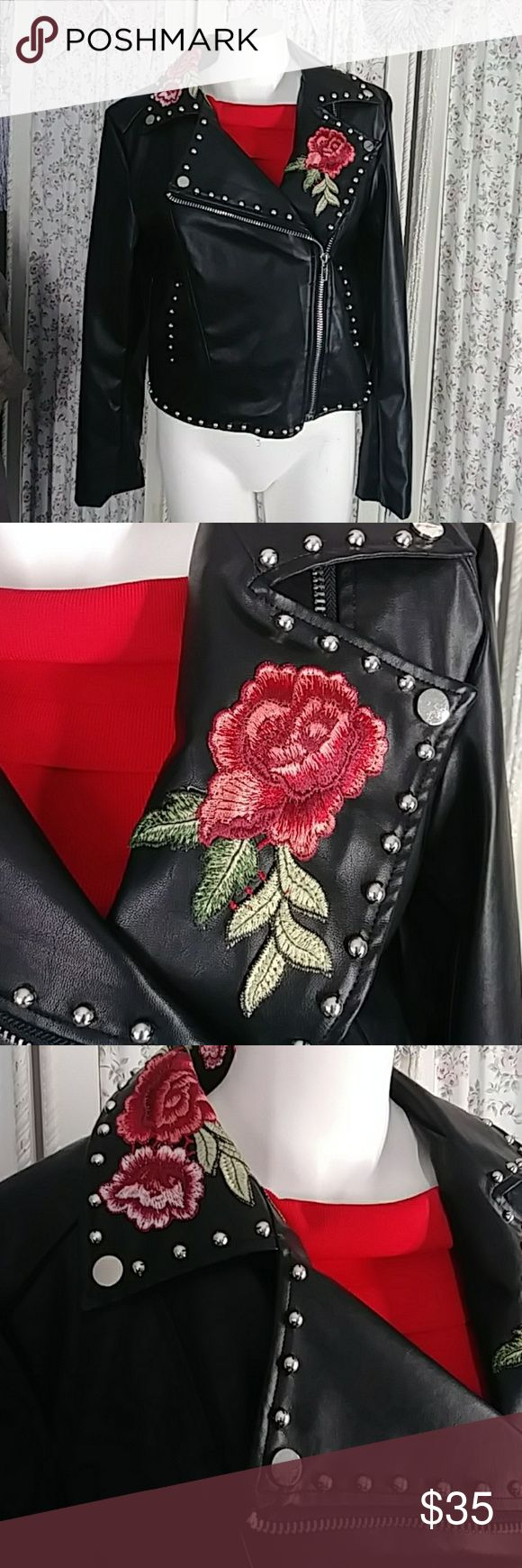 NWT Justify black jacket NWT.  A knock out.  Red embroidered roses in collar.. Large zipper in front. Wipe clean with a sponge. Justify Jackets & Coats Utility Jackets