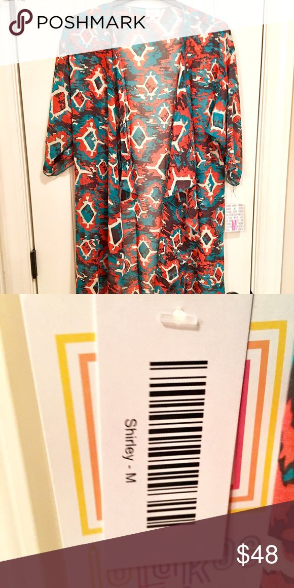 LuLaRoe M Shirley Has black, orange, and teal colors. LuLaRoe Tops Blouses