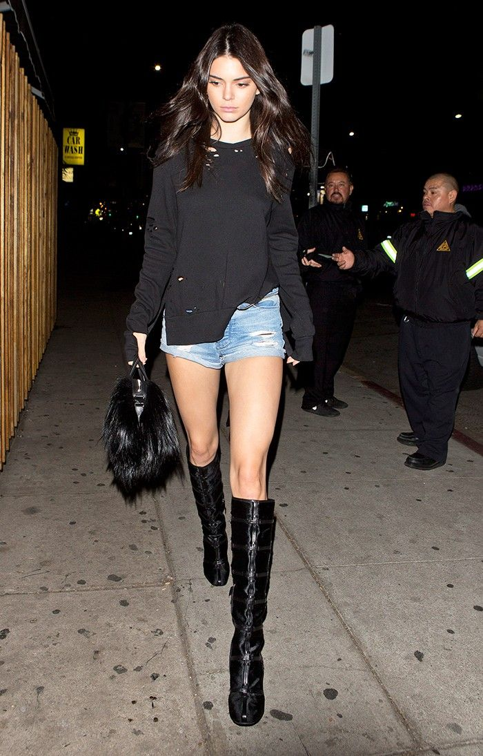 Kendall Jenner Wore Short Shorts With Knee-High Boots at a Club via @WhoWhatWear