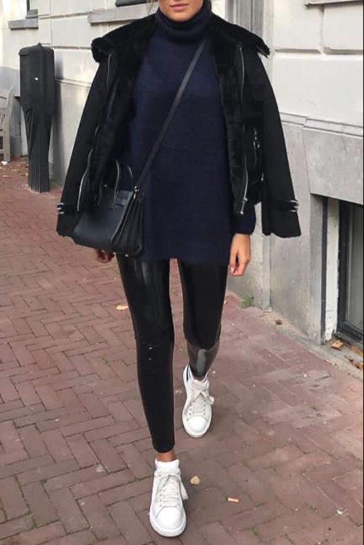 Trendy fall / winter women's fashion with faux leather pants, white sneakers and an aviator coat