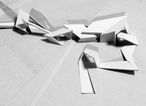 Architectural Model - Daniel Libeskind...Also pure white models displayed as art in living room / hallways, with small lights above them