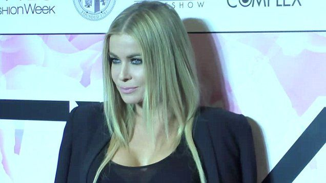 Carmen Electra still looked stunning at age 43 when she attended the Marco Marco's runway show and LA fashion week.  Electra wore a sexy black mini-skirt and matching sheer top.