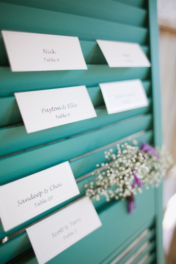 Use an old shutter for event seating assignments!! Simply paint shutter a color of your choice, print names on plain or decorated paper, fold the paper and hang it over one slab of the shutter... Decorate empty  spaces with event flowers.