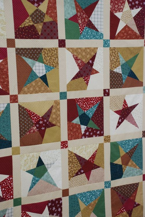 Stars quilt via anyone can quilt. Sort of looks like it may be a buggy barn pattern.  I love this one!