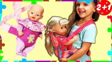 """Беби Бон СТАРШАЯ СЕСТРЕНКА. Рюкзак КЕНГУРУ и кукла. Сумка для куклы Катя. Baby born dolls http://video-kid.com/13323-bebi-bon-starshaja-sestrenka-ryukzak-kenguru-i-kukla-sumka-dlja-kukly-katja-baby-born-dolls.html  Аннушка играет в свою любимую куклу Беби Бон. Кукла очень интересная, это Старшая сестренка Бэби Бон Baby born dolls. Аннушка любит снимать  видео для девочек и играть своими куклами. У нее есть кроватка для Беби бона, коляска и даже рюкзак кенгуру. Новые серии  """"Мультк Пульти…"""