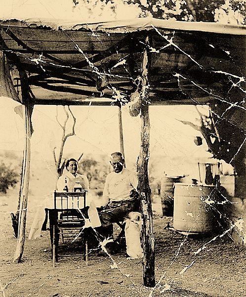 In a rare photo of the couple together, Josie Marcus sits with Wyatt Earp in their desert camp at their Happy Days gold mine, across the river from Parker, Arizona, in the 1920s.