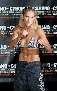 """Cris """"Cyborg"""" Santos may be grossly manly, but she's a badass chick fighter.  She can beat up her (ex)husband, who's nickname is also Cyborg.  'Cause that's not confusing at all.  Her record is 10-1-1."""
